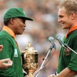 Nelson Mandela congratulates South African rugby team captain Francois Pienaar after they win the 1995 Rugby World Cup at Ellis Park in Johannesburg. (Google Images)