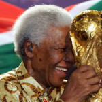Mandela accepts the World Cup trophy in 2004 when South Africa is chosen to host the 2010 World Cup. (AP Photo/Mandela Foundation via World Cup Blog)