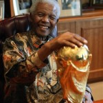91-year-old Nelson Mandela with the World Cup trophy after South Africa held the World Cup in 2010. (AP Photo/Mandela Foundation via World Cup Blog)