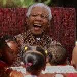 Mandela celebrates his 89th birthday at the Nelson Mandela Children's Fund in Johannesburg. (Denis Farrell/AP Photo via The Guardian)