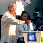 Mandela casts his vote in South Africa's first inclusive democratic election in 1994, which he won to become President. (John Parkin, Associate Press via LA Times)