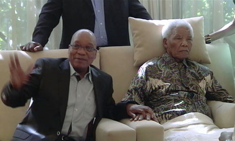 A 'frame grab' of a video of former South African president Nelson Mandela and current President Jacob Zuma