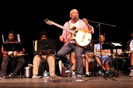 South African musician Jonathan Butler works with youth ensemble in Atlanta. (Photo Credit: DJ Blak Magic)