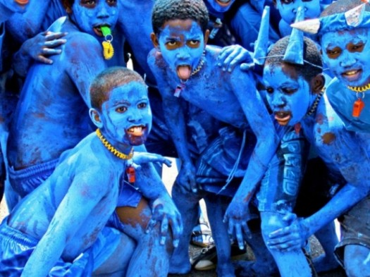 Jouvert celebrations take place throughout the world. Children pose for a picture during Trinidad's Jouvert celebration. (Photo Credit: Google Images)