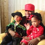 Ne-Yo sits with his children Mason and Madilyn at the event. (Photo credit: DJ Blak Magic)