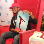 Ne-Yo holds up a photo of himself challenging King of Pop Michael Jackson. (Photo Credit: DJ Blak Magic)