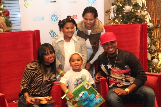 R&B singer/songwriter Ne-Yo takes a picture with attendees of The Giving Back Tour. Actress Keisha Knight-Pulliam is pictured on the left. (Photo Credit: DJ Blak Magic)