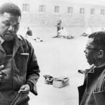 Nelson Mandela and Walter Sisilu in the prison courtyard at Robben Island. (Google Images)