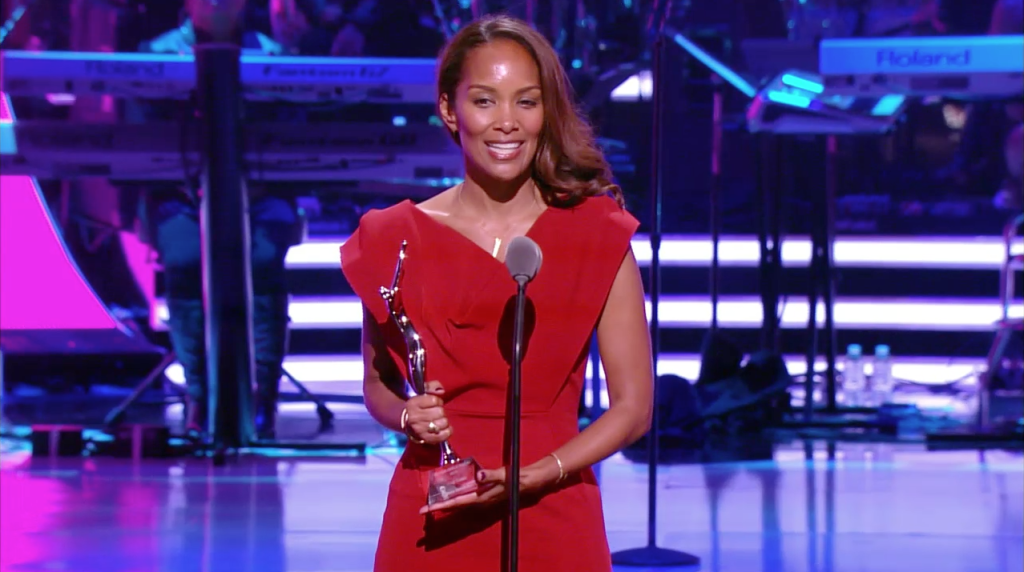 'Being Mary Jane' showrunner Mara Brock Akil accepts award at 2013 BET Black Girls Rock awards show.  (Photo Credit: Google Images)