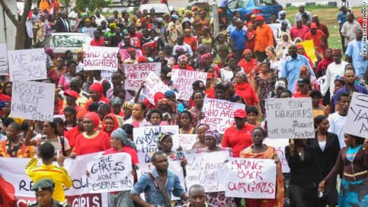 "Protesters carry signs that read ""Bring Back Our Girls"" to raise awareness of the abducted school girls in Nigeria.  (Photo Credit: Turner.com)"