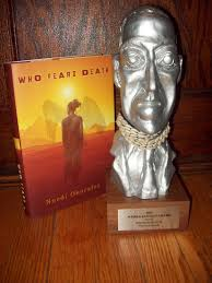 "Nnedi Okorafor's World Fantasy Award next to her book ""Who Fears Death."" (Photo Credit: Google Images.)"