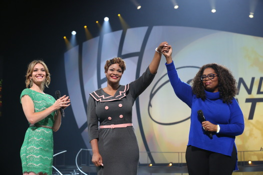 "Oprah Winfrey and Amy Purdy (far left) with Jas Boothe (middle), founder of Final Salute, Inc, recipient of the Toyota ""Standing O-Vation"" Award. (Photo Courtesy of Harpo Studios, Inc. / George Burns)"