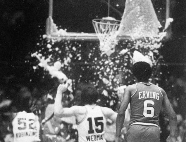 "Darryl Dawkins shatters a backboard while teammate Julius ""Dr. J."" Erving watches. (Photo: Google Images)"