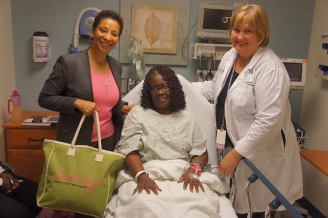 Pinkwellchick Ambassadors Michele Richardson (r) and Dontrey Britt-Hart (l) deliver Barb's Bag™ to a patient at Advocate Health Partners in Chicago. (Photo: Pinkwellchick.org)