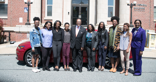 Fellowship recipients McKenzie Marshall, Briahnna Brown, Tatyana Hopkins, Victoria Jones, Sidnee King, and Brelaun Douglas with Dr. Benjamin Chavis, President and CEO of NNPA, Yanick Rice Lamb, Associate Professor; Chair of Department of Media, Journalism and Film at Howard University, Michelle Matthews-Alexander General Motors Diversity Marketing Manager, and Gracie Lawson-Borders, Dean, School of Communications at Howard University posing in front of the all new 2016 Chevrolet Malibu at the C.B. Powell Building at Howard University. (Photo: The Carol Williams Agency)