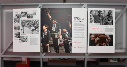 """1968 Olympic sprinters Tommie Smith and John Carlos are acknowledged as part of the civil and human rights-themed exhibit, """"Breaking Barriers: Sports for Change"""" (Photo Credit: ESPYs)"""